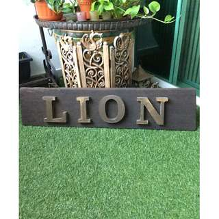 A rare Lion Insurance wooden advertising piece