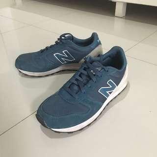 New Balance Turqoise 311