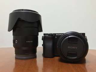 Sony a6000 (body only) + Sony E-mount 35mm f/1.8 lens + Sony E-mount 18-105mm f/4 G lens
