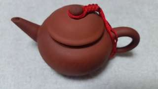 Teapot with a braid