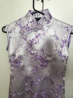 Pretty Cheong-sum. Metallic lilac color outside, purple color inside.  Size on label is L, but small cut.  Neck 14inches; chest 30inches; waist 28inches; hip 30inches; length from neck line is 46inches.   Almost new-Wore only once for a company event.