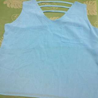 Pre loved sleeveless light blue blouse