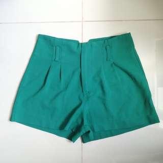 High-waisted green shorts