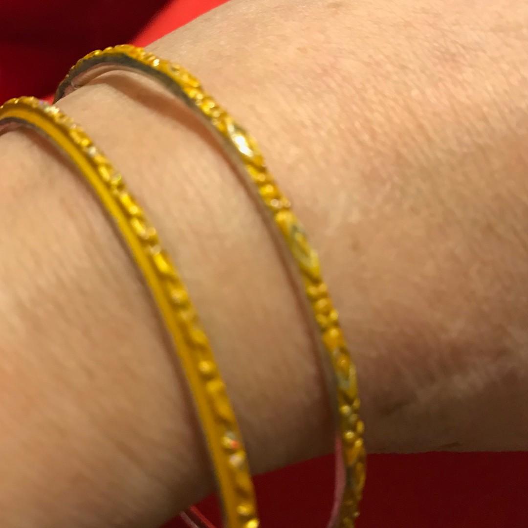 2 pcs orange and 2 pcs yellow metal bangles Made in India