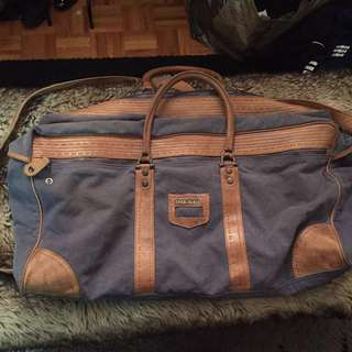 DIESEL large distressed leather and denim duffel bag
