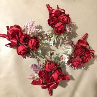 紅色長老襟花