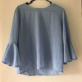Baby blue blouse with bell sleeves