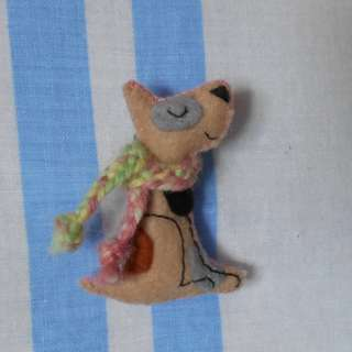Beige and pink dog pin/brooch with hand-woven scarf