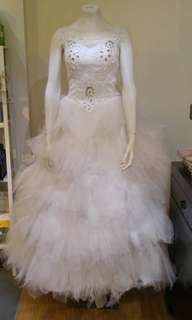 Wedding dress with simple crinoline and veil