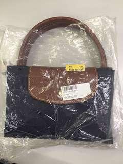 100%new Longchamp 深紫色手抽袋