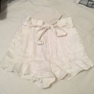 Bardot white silk satin ruffle tie up shorts