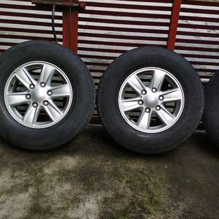 16s Isuzu mux wheels with Bridgestone dueler h/t tires