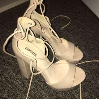 Beige tie up heels