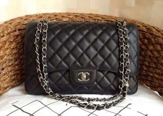 Chanel Maxi Classic Double Flap Bag In Black Caviar Calfskin