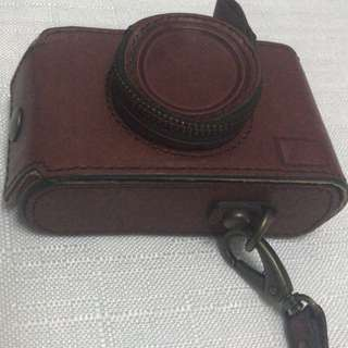 FOSSIL leather camera casing