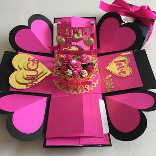 Explosion box with cake , 8 waterfall in black , hot pink & gold