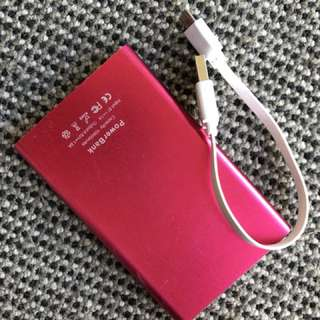 Power bank in hot pink