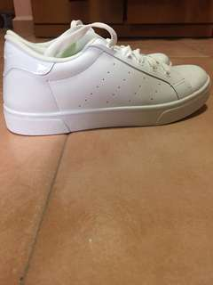Checker's white school shoe