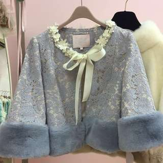 Lace and fur coat by Emily Cheong