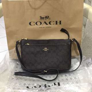 Coach sling with pouch
