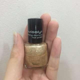 Gold glitter shade nailpolish