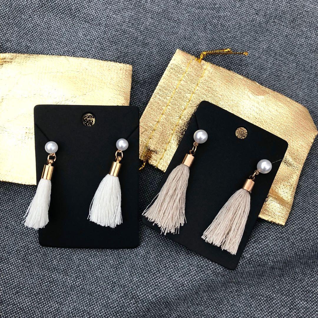 Brand new tasseled earrings in beige / cream white