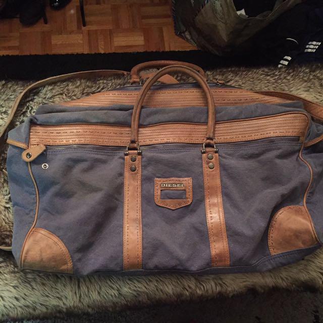 DIESEL large distressed leather and denim duffel bag