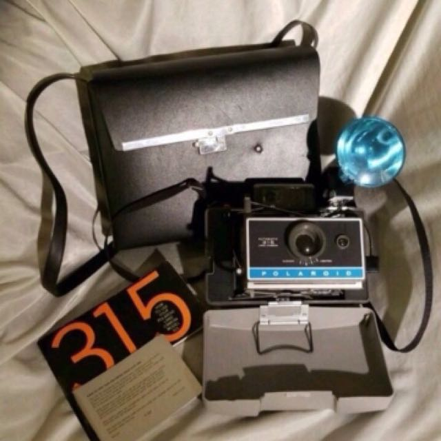 Vintage 315 Polaroid land camera with case flash and accessories