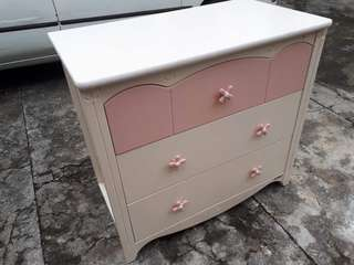 White and Pink wooden Cabiner