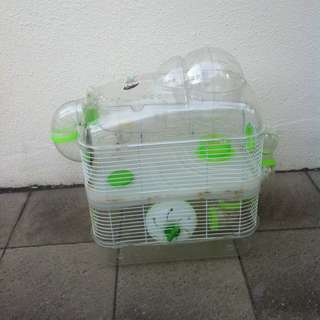 Hamster cage. In good condition. Dimension 55 x 50 x 26cm height.