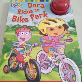 Hardcover Dora rides to bike park with bicycle bell