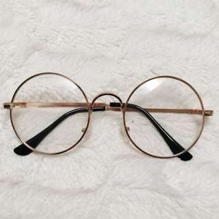Circular no prescription gold glasses