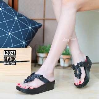 Black flipflop sandals