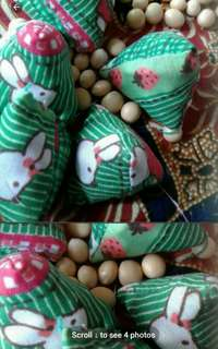 Easter sunday bunnies Rabbits in green field Five stones  Assorted designs fabrics and prints