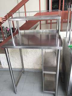 Stainless steel table with rack