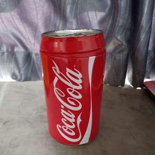 Giant coca cola coin bottle