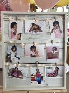 Wooden photo board display with fairlights [for rent]