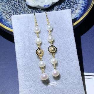 8 Natural freshwater pearl earrings,