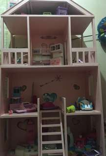 Doll house only. Made of wood.