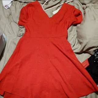 Red skater dress with emboss-like prints