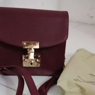 Snoeren Maroon Sling Bag by Adorableprojects