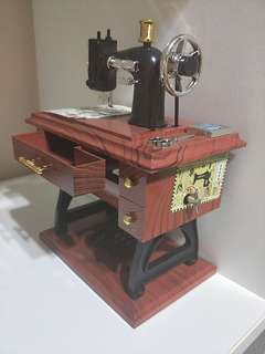 BRAND NEW!! MUSICAL BOX SEWING MACHINE FOR YOU OR UR LOVED ONES WHO LOVES FASHION & SEWING!! BEAUTIFUL MELODY MAKES IT A GREAT GIFT!! ONLY 1!! HURRY WHILE STOCK LAST!! GRAB BEFORE ITS GONE!! ITEM AND BOX IN VERY GOOD CONDITION!! HURRY!!