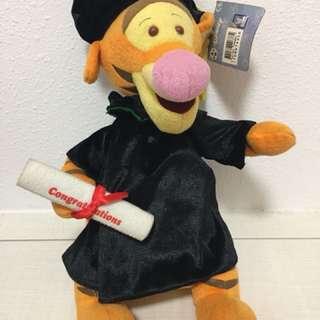 Tigger in graduation gown