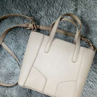 Charles & Keith sling bag (small beige)