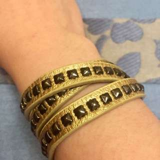 Gold leather bracelet with studs