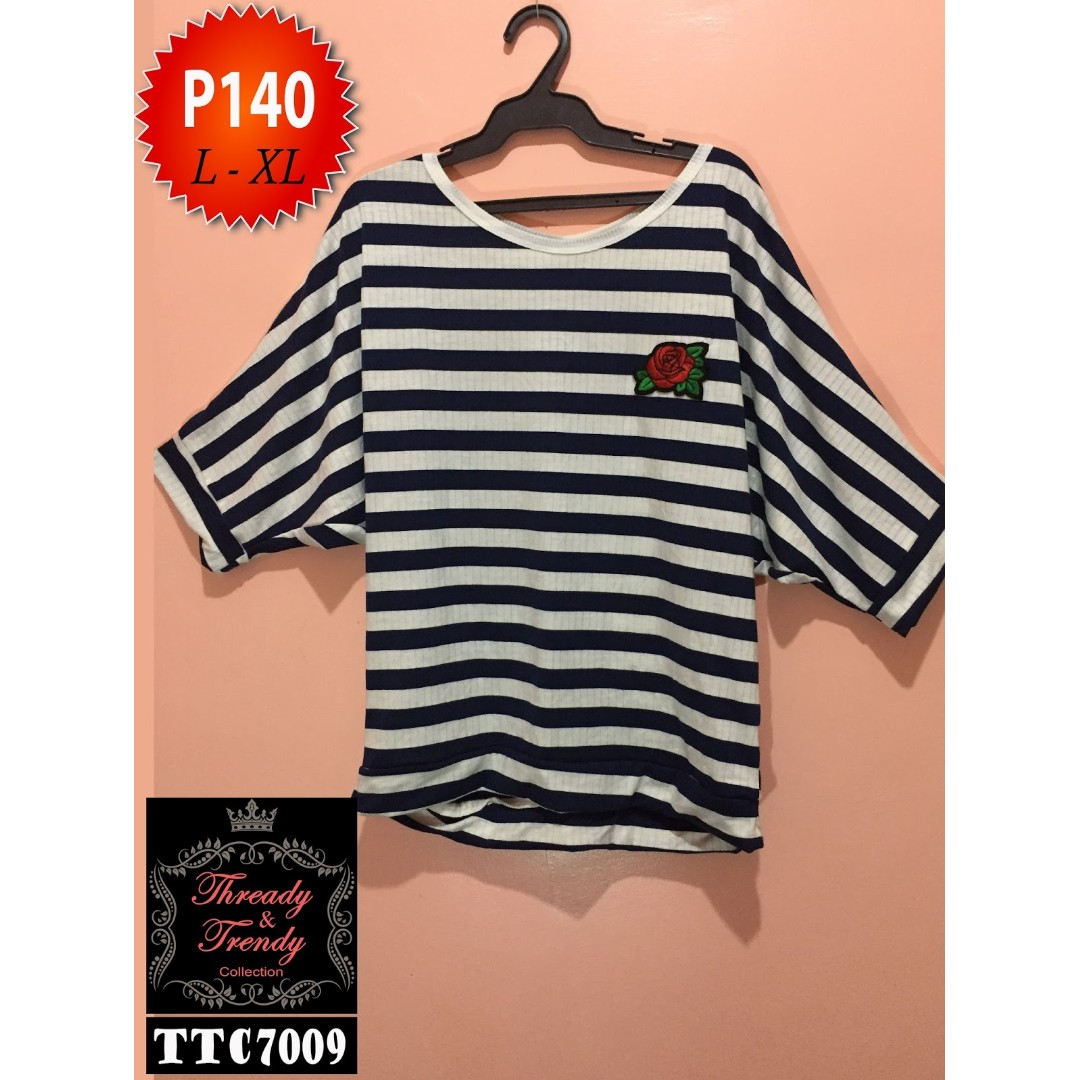 107343106be Plus size navy blue white striped blouse with flower patch