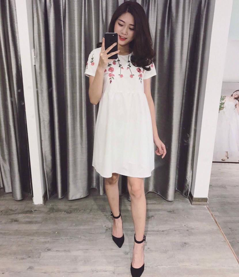 White dress with floral embroidered pattern