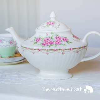 Shabby chic vintage teapot, pretty pink roses, floral swags and garlands