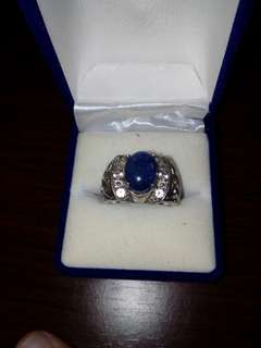 3 carat cabachon Ceylon sapphire center with white sapphire, rhodium plated sterling silver ring. Size 9