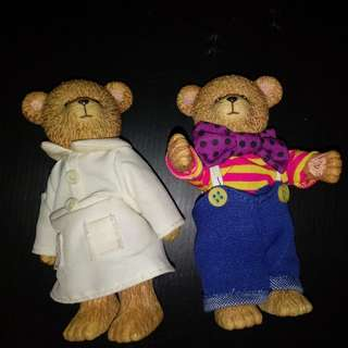 A pair of vintage plastic figurine
